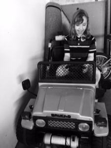 My awesome girl in a old still working toy jeep. :-)