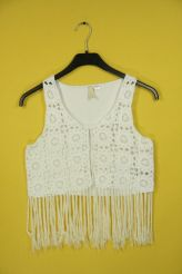 White crocheted fringe vest.